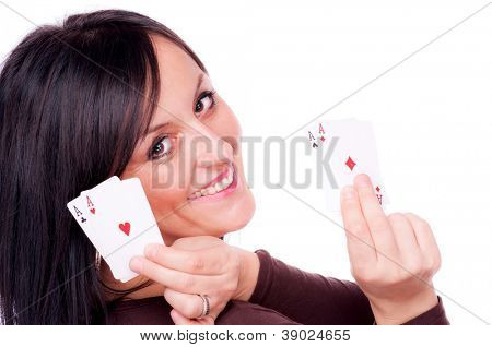 Woman holding four aces in her hands, isolated on white - all aces in my hand concept