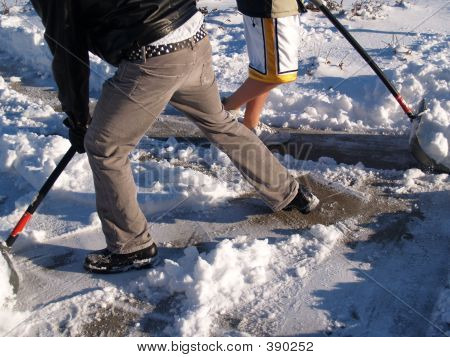 Two Teens Shoveling Snow