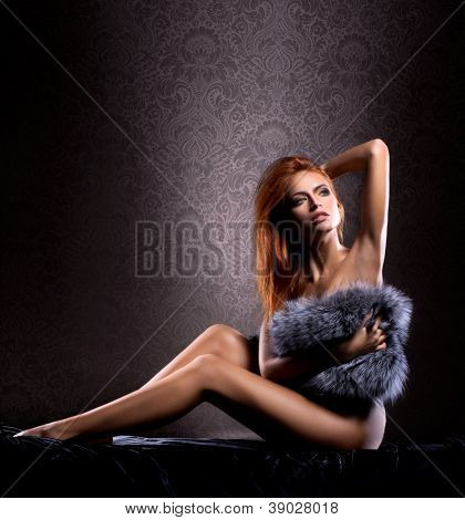 Young sexy naked woman over vintage background