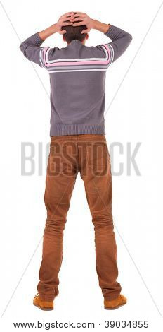 Back view of shocked business man in sweater .   upset young guy in jeans. Rear view people collection.  backside view of person.  Isolated over white background.