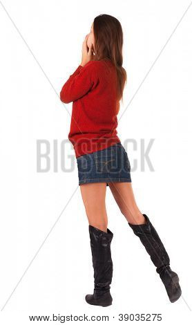 back view of standing young beautiful  woman.  blonde girl in red sweater watching. Rear view people collection.  backside view of person.  Isolated over white background.
