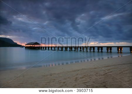 Serene Pier In Hawaii At Sundown