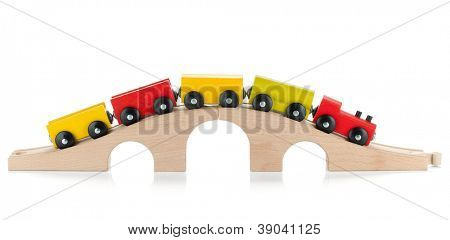 Wooden toy colored train. Isolated on white background