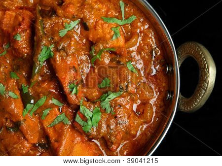Indian chicken jalfrezi curry food in balti dish
