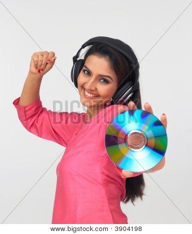 Young Asian Woman Of Indian Origin Enjoying Music