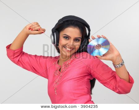Woman Of Indian Origin Enjoying Music