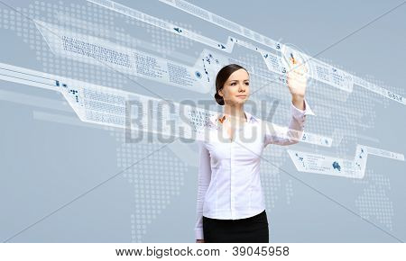 Young woman in business wear working with digital touch screen