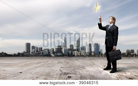 businessman in blue suit standing and juggling business symbols