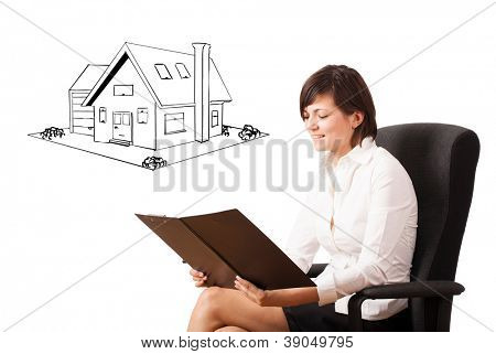Young business woman presenting a house on whiteboard isolated on white