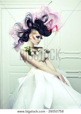 Lady with avant-garde hair and bright make-up