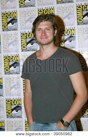 SAN DIEGO, CA - JULY 15: Tom Weston-Jones arrives at the 2012 Comic Con convention press room at the Bayfront Hilton Hotel on Sunday, July 15, 2012 in San Diego, CA.
