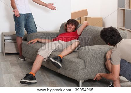 Three men arranging furniture