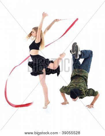 Rapper stands on hands and graceful gymnast girl spins on one leg isolated on white background.