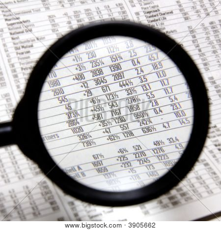 Magnifying Glass Over Stocks And Shares Page In A Newspaper