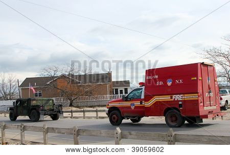 Us National Guard And Fire Department Vehicles Moving To Devastated Area