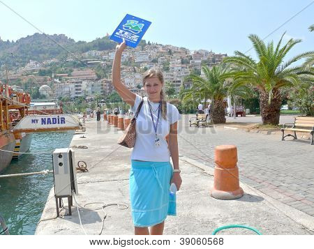 Alanya, Turkey - September 01, 2008: Representative Of Tez Tour Company Waits Tourists Near The Yach