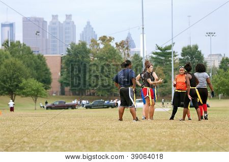 Female Flag Football Players Prep For Next Play