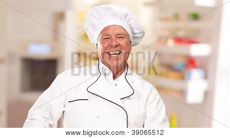 Male Chef Stirring A Non Stick Pan, Indoor