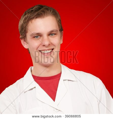 Portrait of a doctor using a tablet on red background