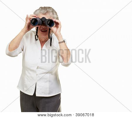 Portrait of a senior woman looking through binoculars on white background