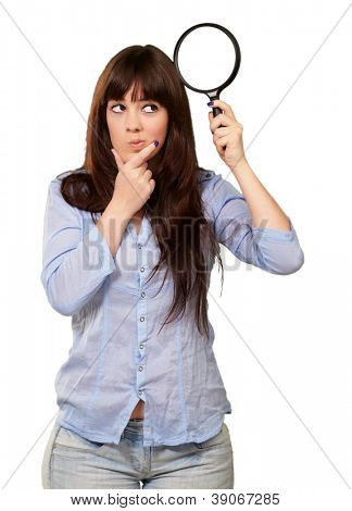 Portrait Of A Girl Holding A Magnifying Glass And Thinking On White Background