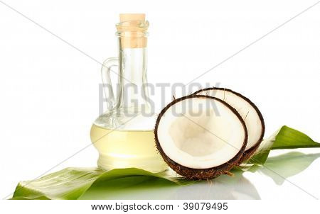 decanter with coconut oil and coconuts isolated on white