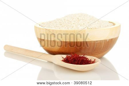 stigmas of saffron in wooden bowl with spoon isolated on white close-up