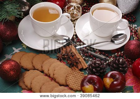 Christmas still life with tea and biscuits on the table