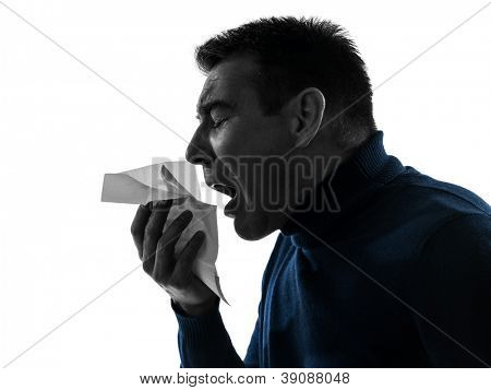 one causasian man sneezing portrait in silhouette studio isolated on white background