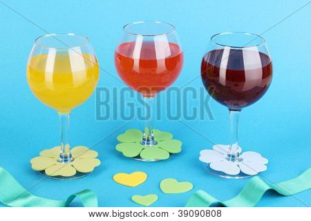 Colorful cocktails with bright decor for glasses on blue background