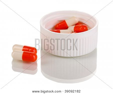 Dispenser for tablets with pills isolated on white