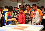 SUBANG JAYA - NOVEMBER 10: Unidentified elementary students prepare their robot for the 'robot organ