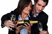 stock photo of pushy  - Couple celebrating with a glass of wine - JPG