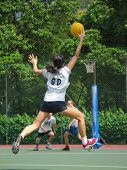 stock photo of netball  - Netball - Player reaching for the ball