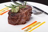 pic of chateaubriand  - Closeup of a gourmet dinner plate with a steak - JPG