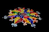 stock photo of swastik  - Rangoli hand sketched patterns and designs filled colored powder are a common item in hindu homes at divali and new year usually accompanied by ghee  - JPG