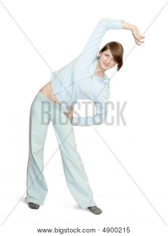 Smiling Girl Doing Aerobics  Over White Background