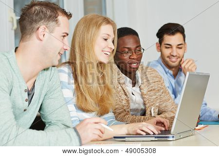 Happy students taking private lessons online with laptop computer