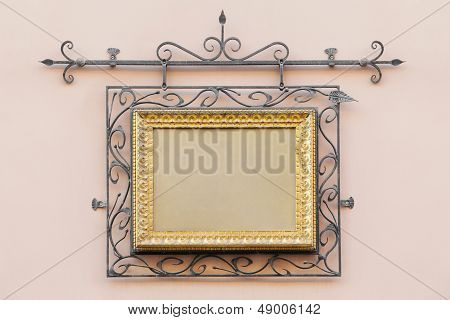 Vintage Frame Decorated With Wrought Iron On The Home Wall Of  House Outdoors