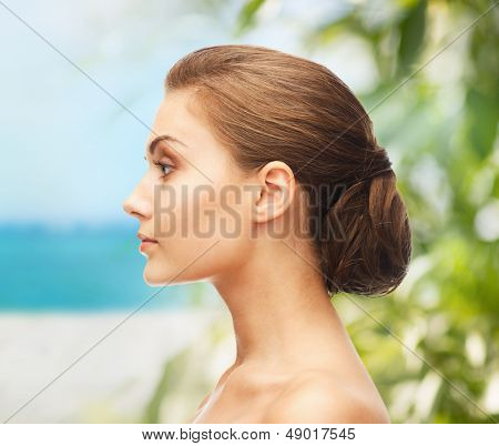beauty and jewelry concept - face of beautiful woman