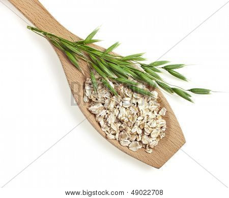 wooden spoon with oat seeds close up  top view surface isolated on white background