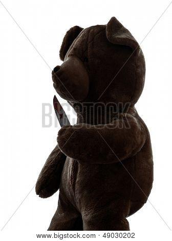 one  strange killer teddy bear holding bloody knife  in silhouette white background