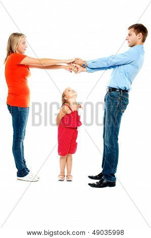 Playful Family Of Father, Mother And Daughter
