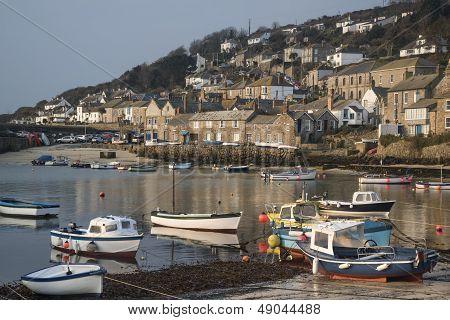 A traditional Cornish fishing village and harbor Cornwall England