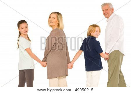 Young Grandmother Grandfather With Nephew And Niece Standing Hand-by-hand On White Background