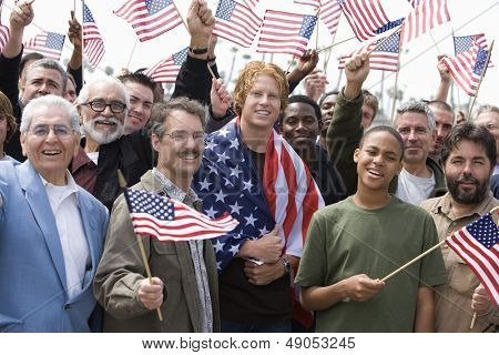 Large group of men holding American flag