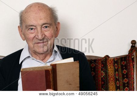 Portrait Of A Grandpa Reading A Book