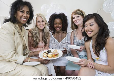 Portrait of a woman celebrating bridal shower with multiethnic friends