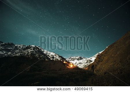 Fire in rugged mountainous landscape