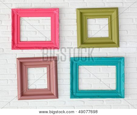 four photo frames on the white wall